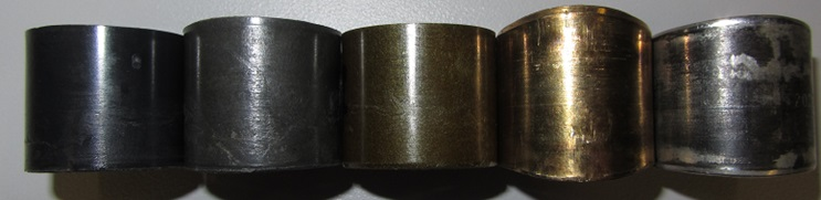 Wear result after test at 30 MPa load. (left to right:) Plastics: iglidur® Q, iglidur® G, iglidur® Z. Metal: Brass, Steel with PTFE liner. The latter two and iglidur® G show varying degrees of length increase