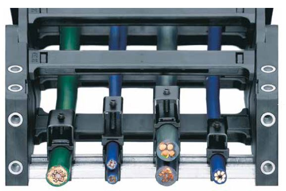 Strain relief devices for e-chains® with clamps or stacker elements. The principle of clamps has more than proven its worth as a means of strain relief for igus® e-chain systems®. Clamps are a suitable means of strain relief for all e-chains® with KMA mounting bracket and C-rails option.