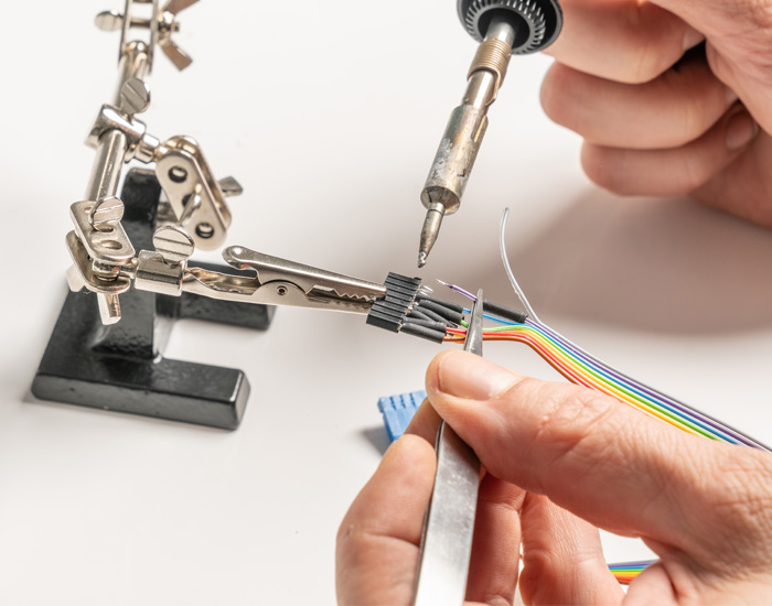 Soldering a cable with a soldering iron